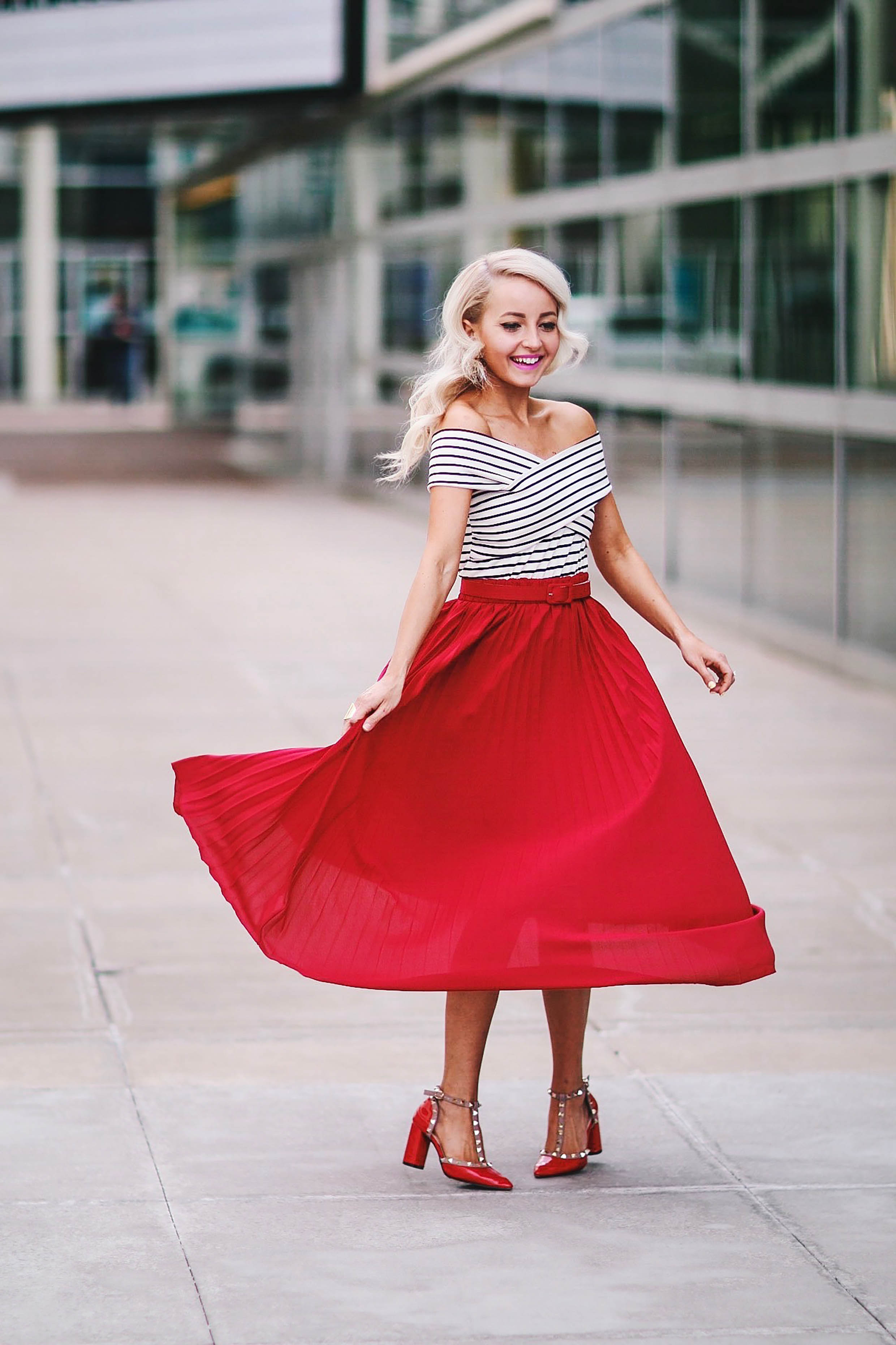 TAKING YOUR RED PLEATED SKIRT OUT
